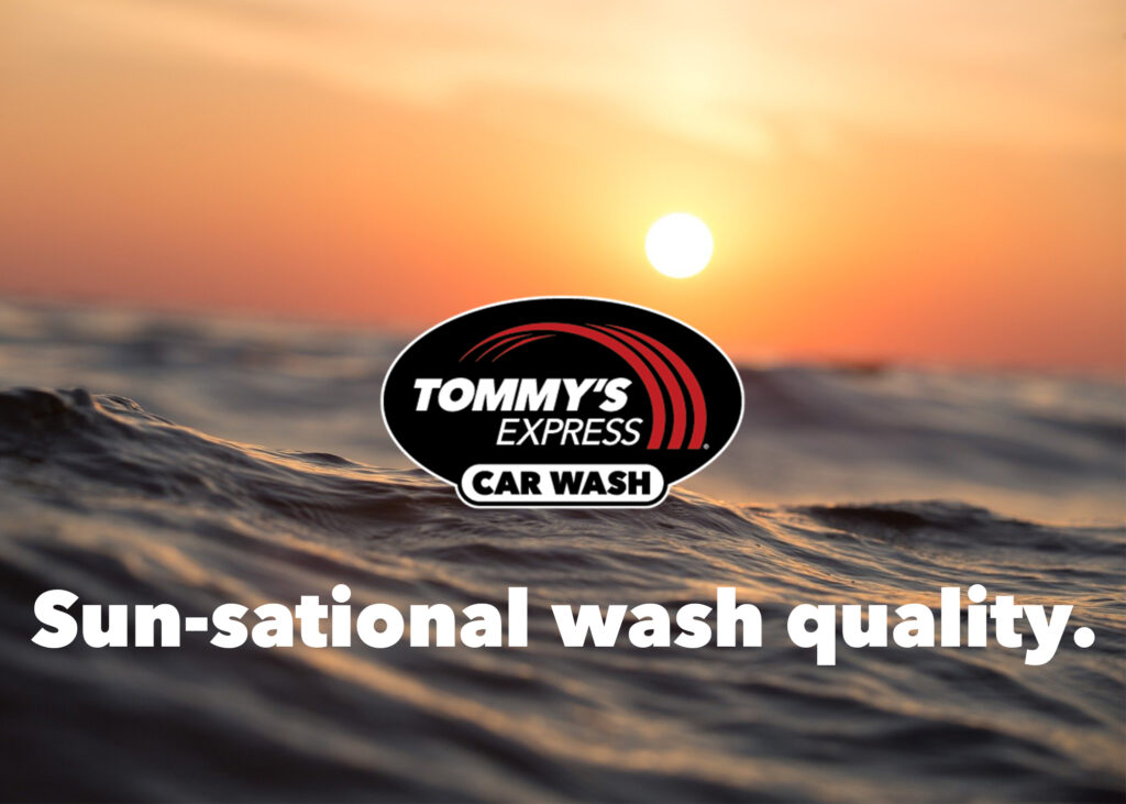 """A sunset on the water with the Tommy's Express logo and """"Sun-sational wash quality"""" text overlayed"""